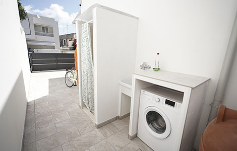 External shower and washing machine.